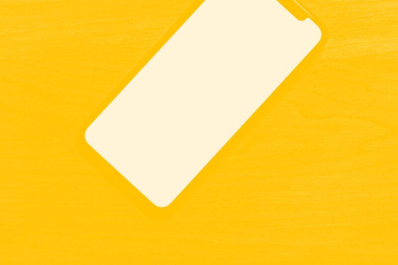 Fotografia de um telemóvel o ecrã preferencial de trabalho das agências digitais