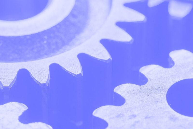 Fotografia de várias rodas dentadas alusiva ao conceito de design systems